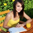 Stock Photo: Pretty girl with book in the garden