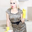 Стоковое фото: Sexy housewife cleaning the kitchen