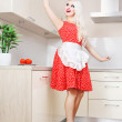 Sexy housewife cleaning the kitchen — Stock Photo