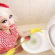 Attractive girl cleaning toilet — Stock Photo