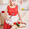 Crazy housewife with a knife — Stock Photo