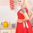 Cheerful housewife in the kitchen — Stockfoto