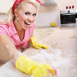 Stock Photo: Sexy housewife doing housework