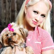 Cute girl with dog - Stock Photo