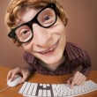 Stock Photo: Funny guy at the computer