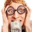 Funny nerd with dollars in a mouth — Stock Photo