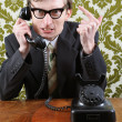 Stock Photo: Retro manager angry on phone