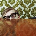 Funny nerd hiding behind a desk — Stock Photo #5821555