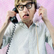 Stock Photo: Nerd talking by phone