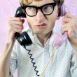 Foto Stock: Nerd talking by phone