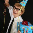 Cute party boy with a gift — Stock Photo