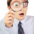 Excited nerd with magnifying glass — Stock Photo