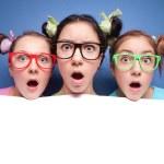 Three amazed teens with blank — Stock Photo