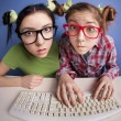 Twin sisters at the computer — Stockfoto #5821708
