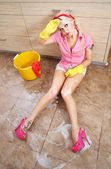 Sexy housewife doing housework — Stock Photo