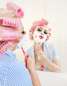 Attractive girl is having a shave — Stock Photo