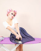 Funny girl ironing skirt — Stock Photo