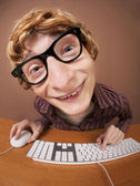Funny guy at the computer — Stockfoto