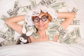 Sleeping with money — Stok fotoğraf