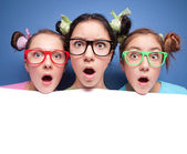 Three amazed teens with blank — Foto de Stock