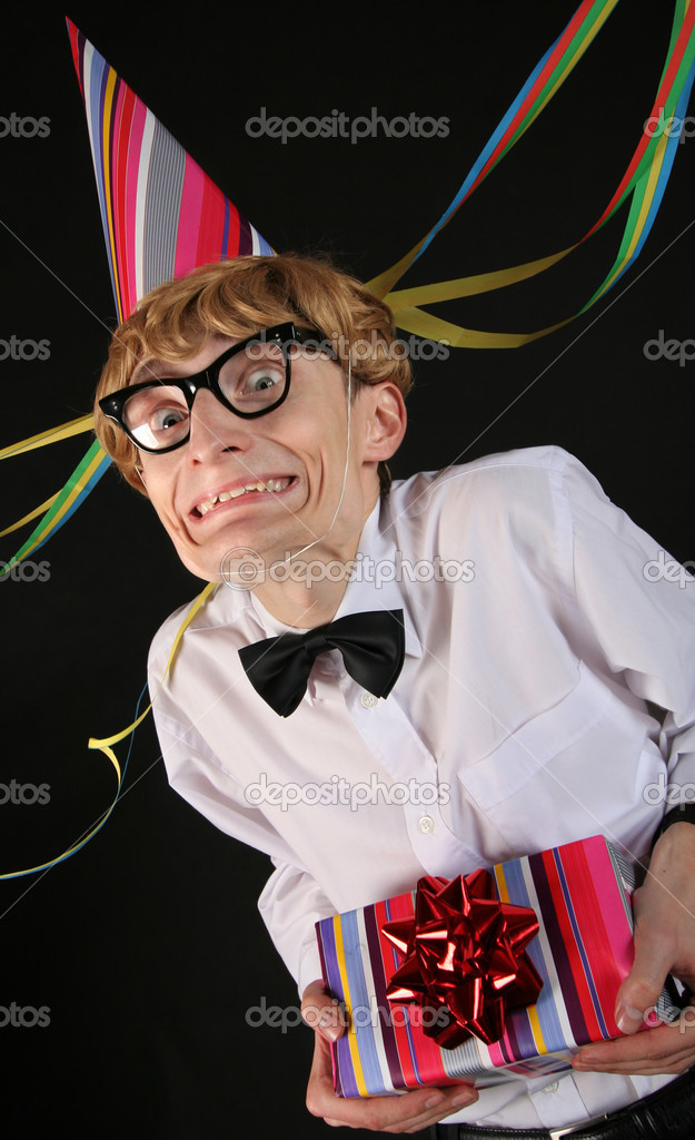 Cute party boy with a gift  Stock Photo #5821605