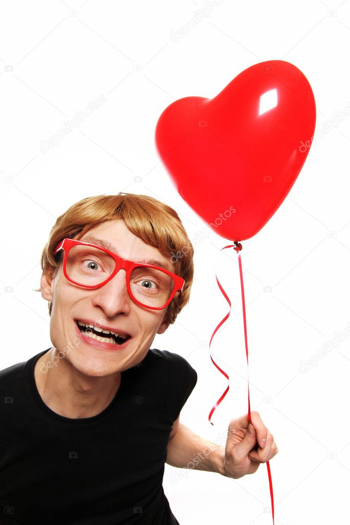 Happy guy with a heart balloon — Stock Photo #5821628