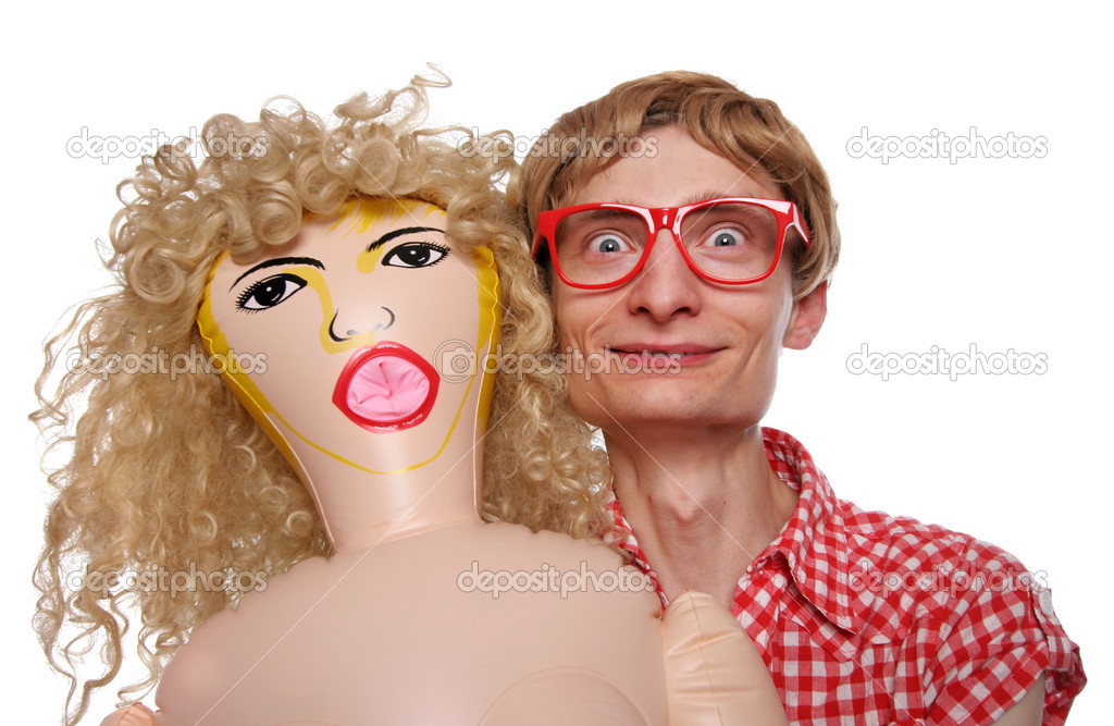 Guy with a blow-up doll  Stock Photo #5821630