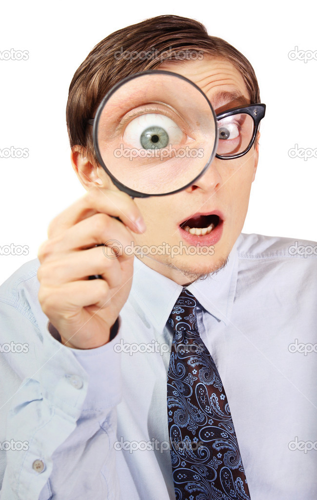 Excited nerd with magnifying glass — Stock Photo #5821638