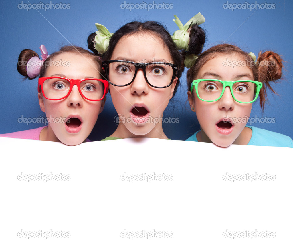 Three amazed teens with blank  Stock Photo #5821700
