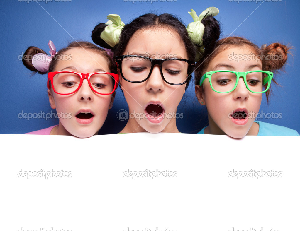 Three amazed teens with blank — Stock Photo #5821702