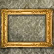 Gold frame, aged wallpaper — Stock Photo