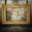Grunge interior with gold frame — Stock Photo