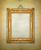 Gold frame, aged wallpaper — Stockfoto
