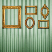 Gold ornate frames & retro wallpaper — Stock Photo