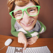 Stock Photo: Funny guy at computer