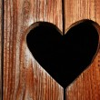 Stock Photo: Wooden door with heart