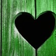 Wooden door with heart - Stock Photo