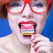 Pretty girl eating candy — Stock Photo