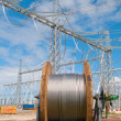 Cable reel in front of power line construction site — Stock Photo