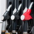Royalty-Free Stock Photo: Pump nozzles at the gas station