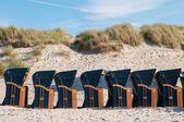 Canopied beach chairs — Stock Photo