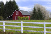 A red barn in a countryside. — Stock Photo