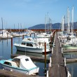 Fishing boats &amp; small yachts in a marina. - Stock Photo