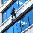 Pressure washing a building. - Stok fotoraf