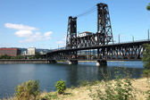 The steel bridge a busy thoroughfare, Portland OR. — Stock Photo