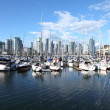 Vancouver BC waterfront skyline & sailboats. - Stock Photo