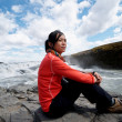 Asian girl at Gullfoss waterfall - Zdjęcie stockowe