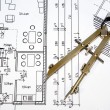 Stock Photo: Architectural drawing and tool