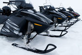 Skidoo's in a row — Stock Photo
