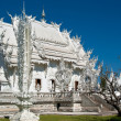 Wat Rong Khun, the white temple - Stock Photo